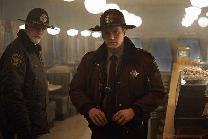 Two sheriffs stand in an restaurant in Fargo Season 2