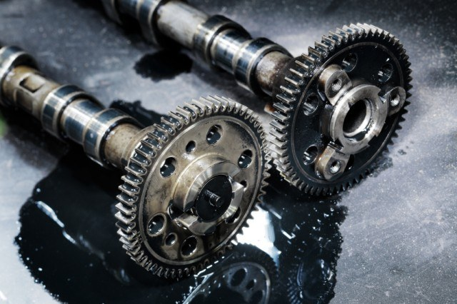 A set of camshafts out of a turbo diesel motor await their new donor motor | iStock