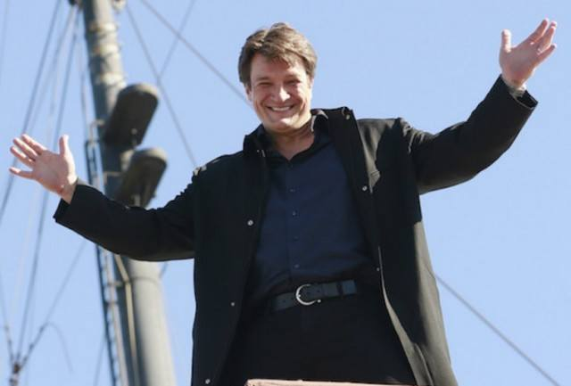 Nathan Fillion stands on a boat in ABC's 'Castle'.