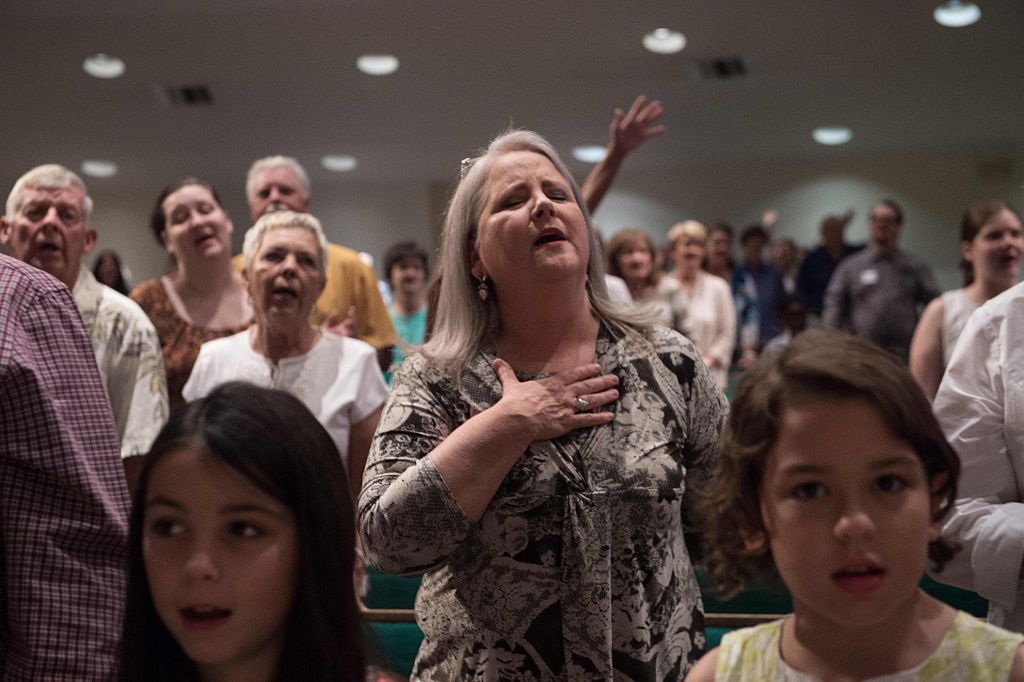 Christian evangelicals attend a church service