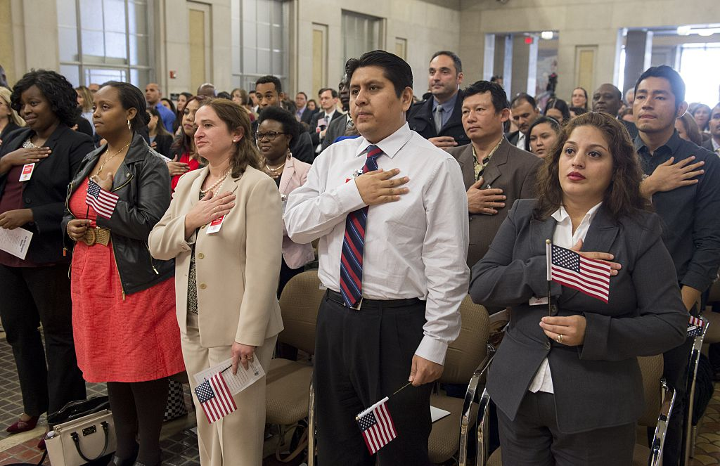 Immigrants undergoing naturalization at the Department of Justice in Washington, DC