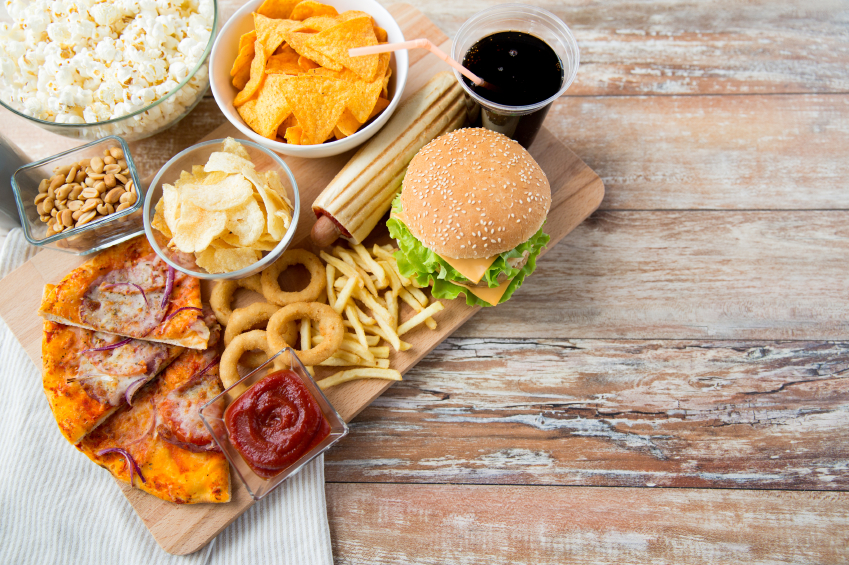 junk food on a wooden table