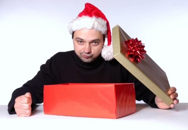 man disappointed with Christmas gift