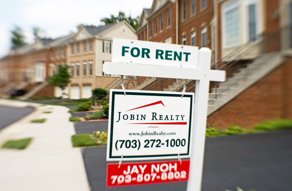 for rent sign by townhomes