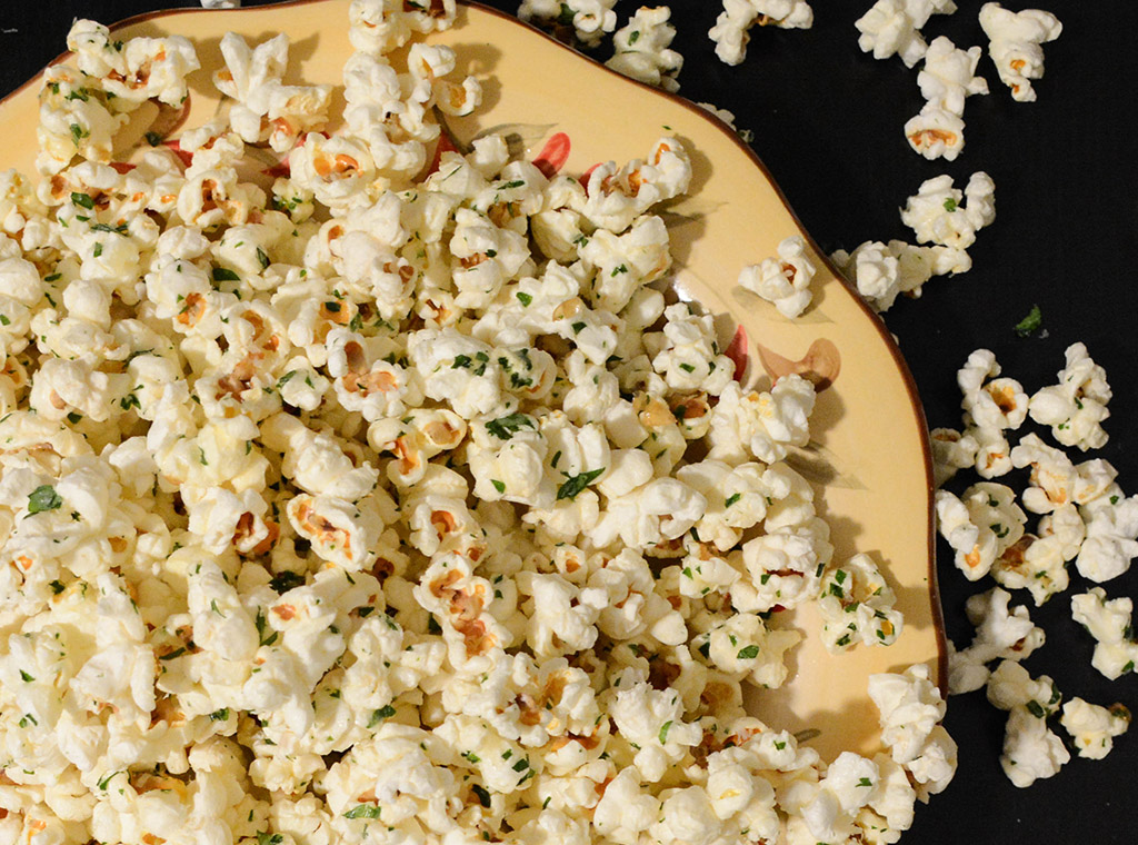 Garlic Parmesan Popcorn with Parsley in a yellow bowl
