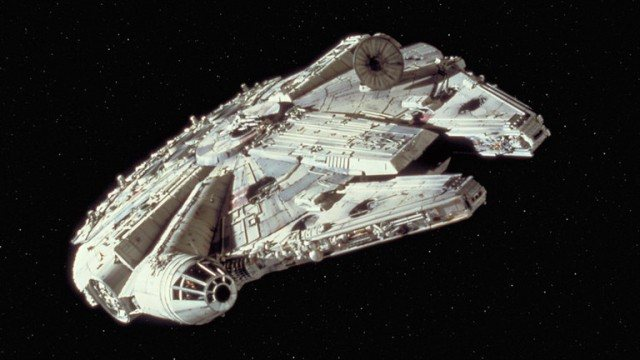 A Millenium Falcon on a dark black background with stars.