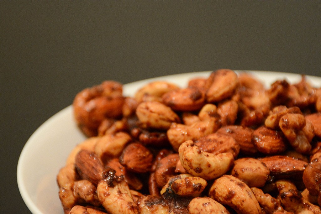 Close up of spicy maple mixed nuts in a white bowl