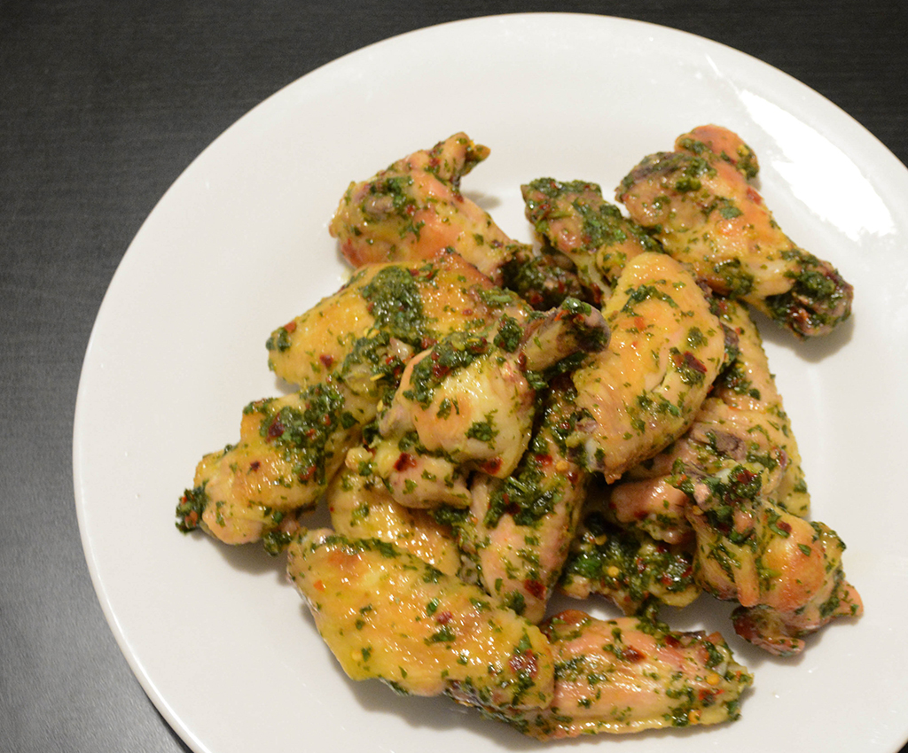 Baked Thai Chicken Wings with Cilantro, Lime, and Honey on a white plate