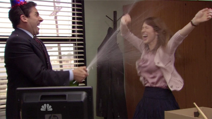Michael Scott celebrates with his receptionist on NBC's The Office