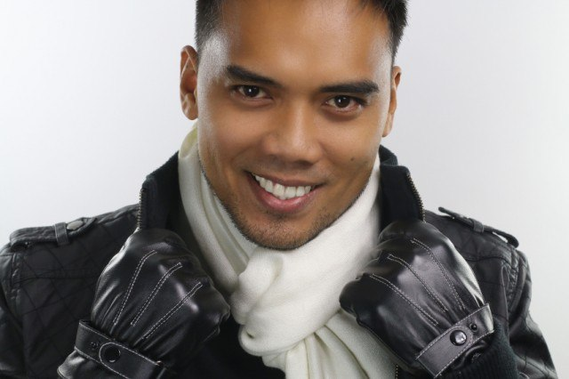 man wearing a scarf, jacket, and gloves