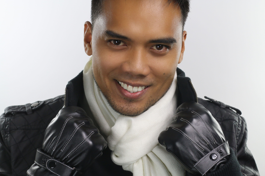 stylish man wearing winter jacket and gloves