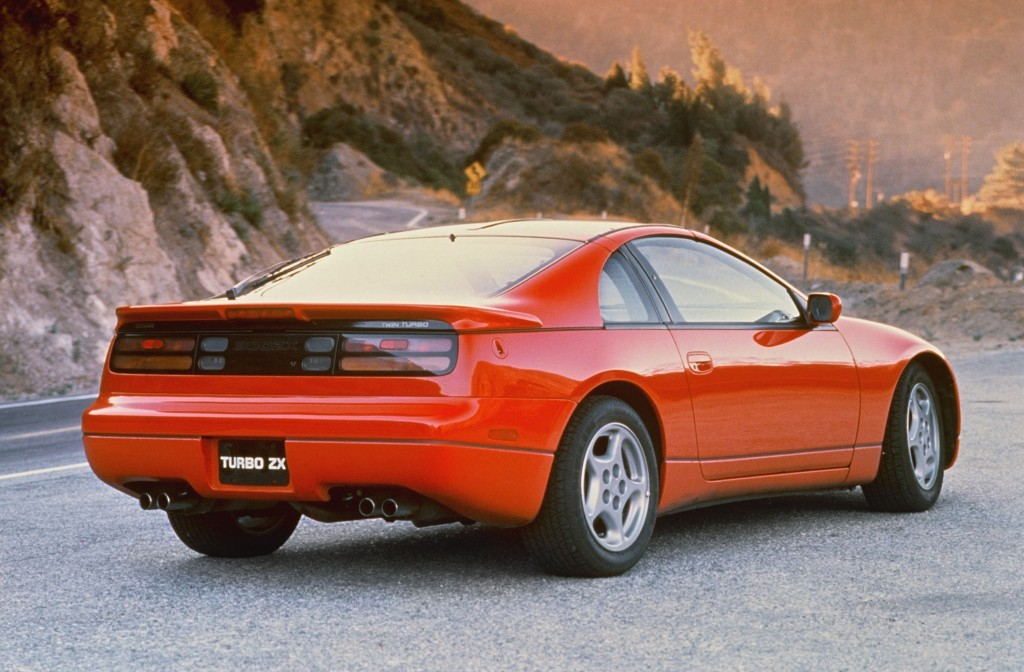 A red 1990 Nissan 300ZX parked to the side of a road.