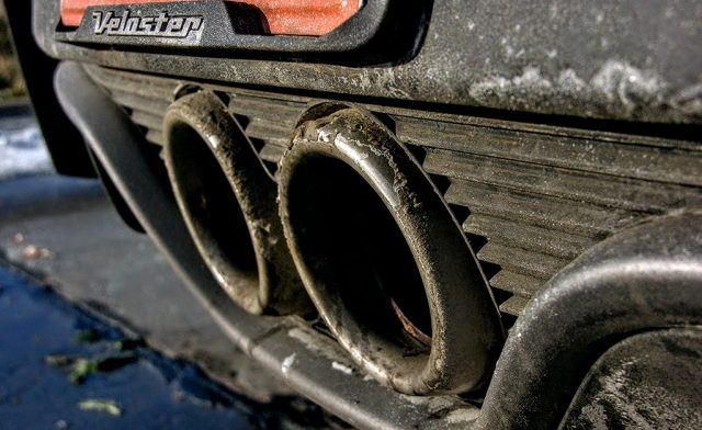 Road salt, snow, grime, and exhaust soot cling to the dual-port exhaust on the Hyundai Veloster Rally Edition