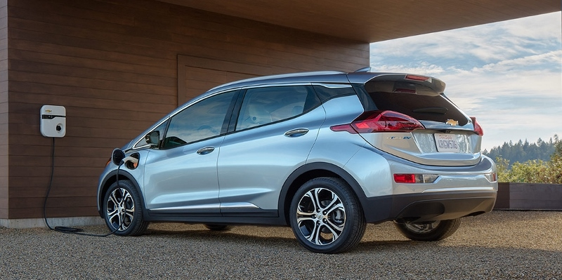 A Chevrolet Bolt EV is charged in the garage