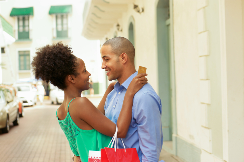 Happy African American couple enjoying shopping