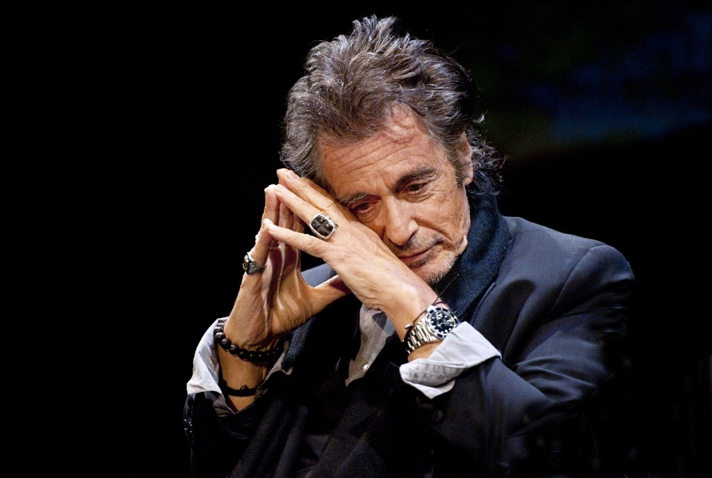 Al Pacino rests his head on his hands.