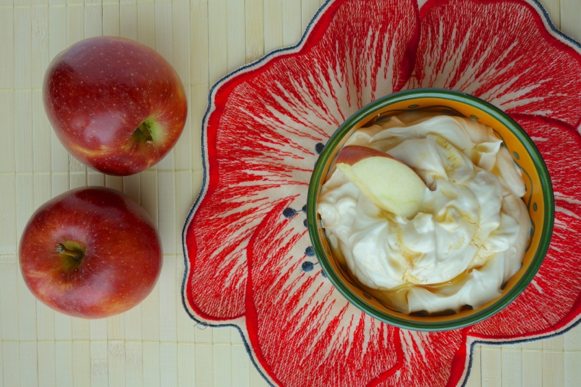 overhead shot of a bowl of yogurt with honey and apples