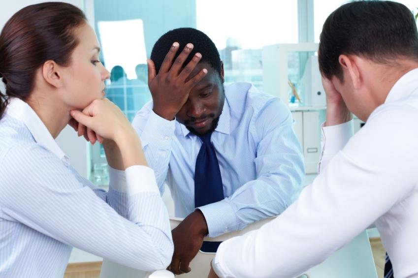 worried members of business team sitting in office