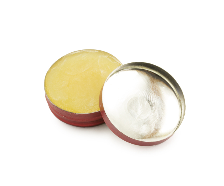 opened can of balm ointment on white background