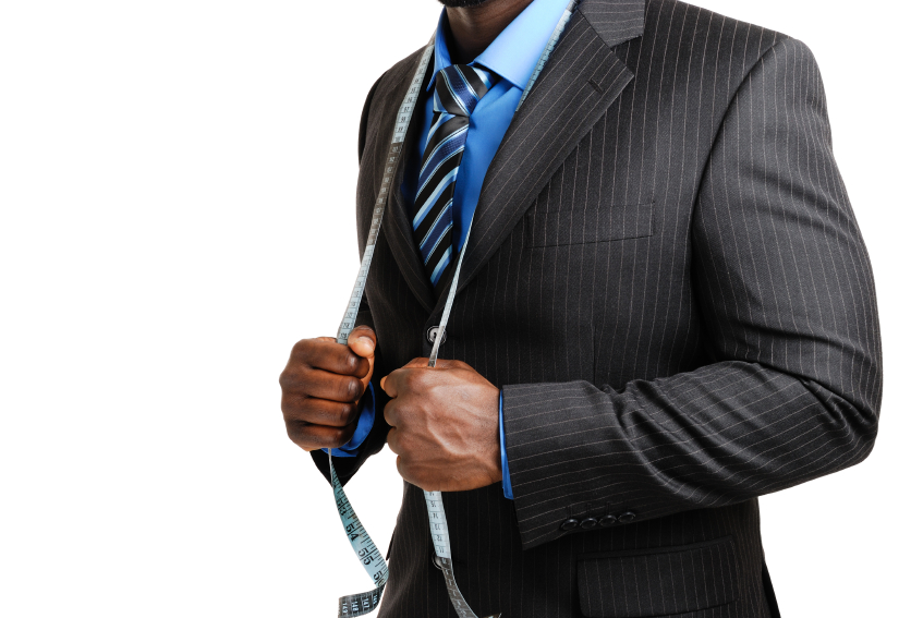 man in suit with tape measure