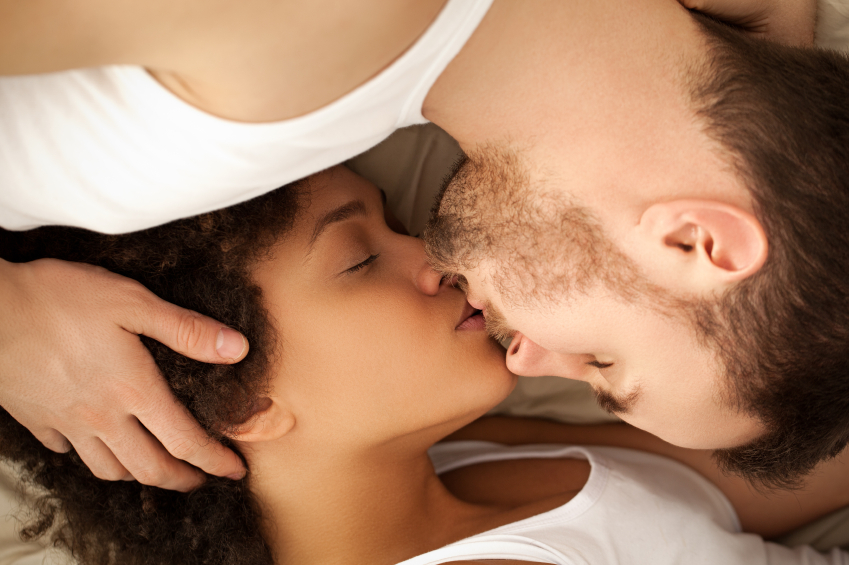man and woman kissing each other
