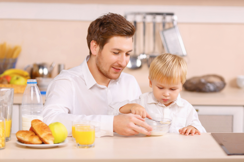 dad eating breakfast with son