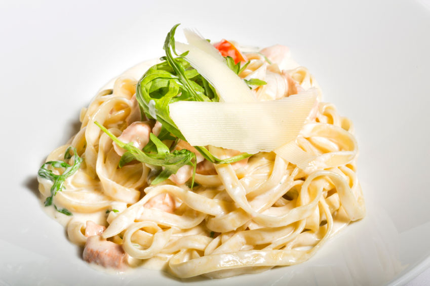 white sauce salmon pasta with white background