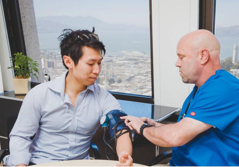 A nurse taking a man's blood pressure