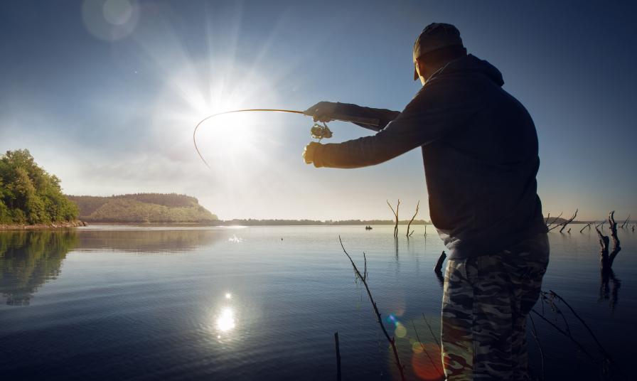 man fishing in sunset