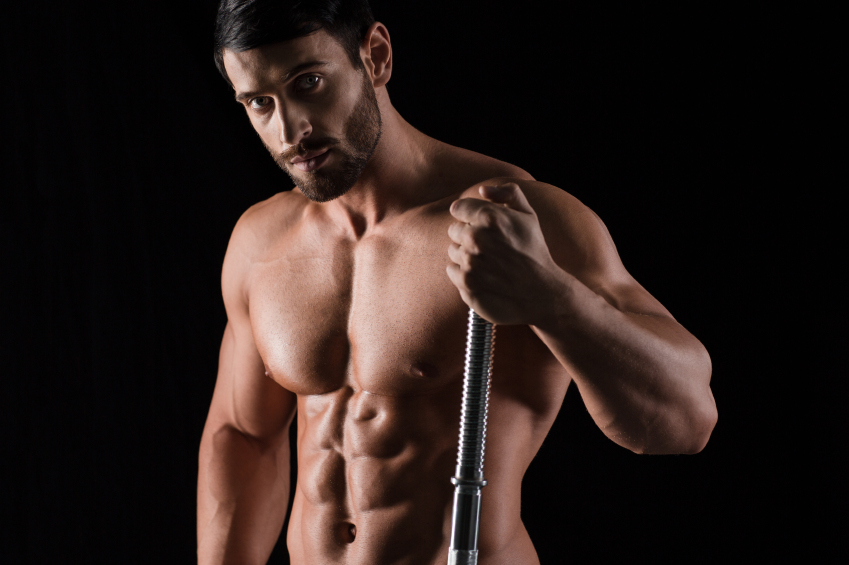 close shot of a fit man holding end of a barbell