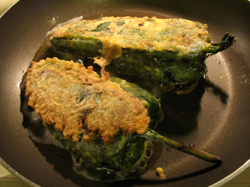 Chile Rellenos frying in a pan
