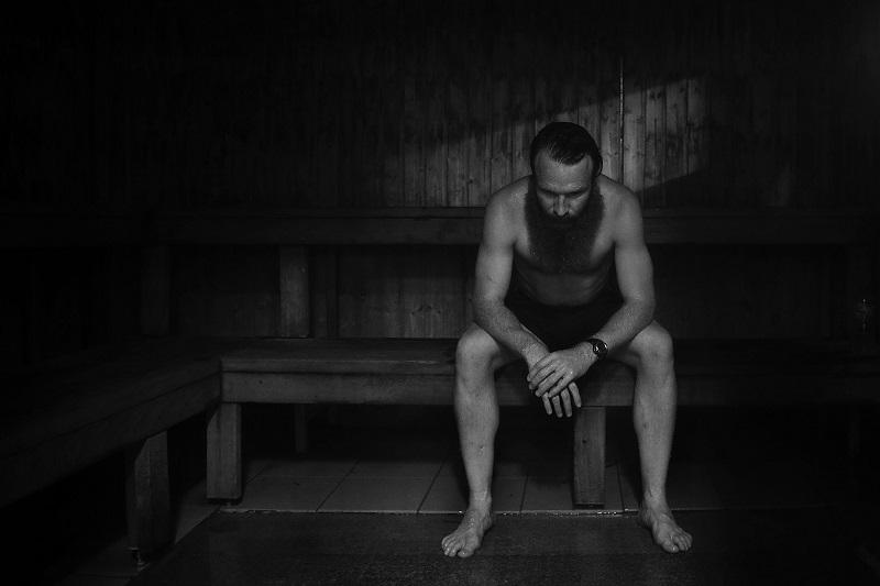 a man sitting in a sauna