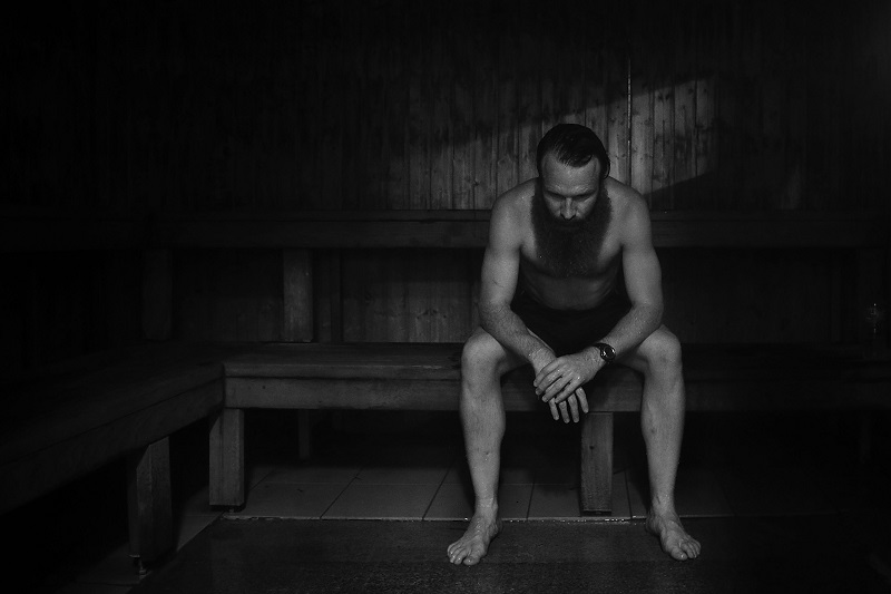 a man sitting in a sauna
