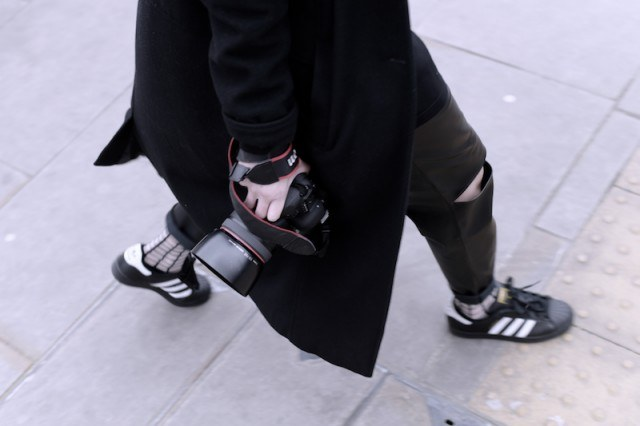 Man in black adidas sneakers