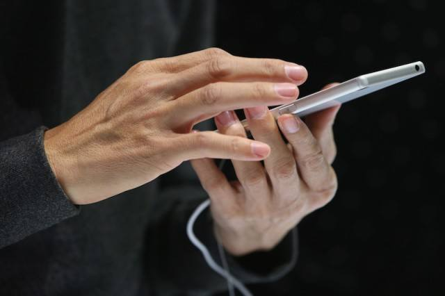 Man holding a smartphone in his hands