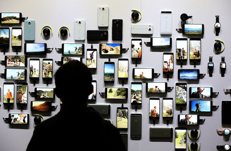 An attendee looks at a display of new Google device