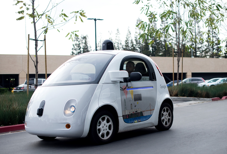 A self-driving car traverses a parking lot at Google's headquarters in Mountain View, California on January 8, 2015.
