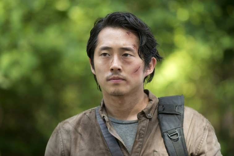 Glenn (Steven Yeun) looks serious in a scene from AMC's hit show, 'The Walking Dead.'