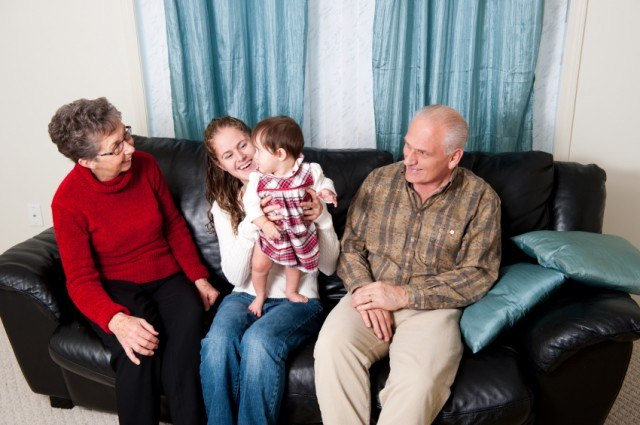 grandparents with adult child and grandchild
