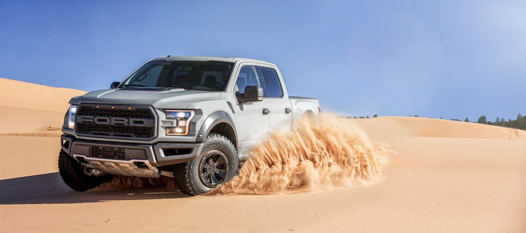 A 2017 Ford F-150 Raptor plays in the dunes