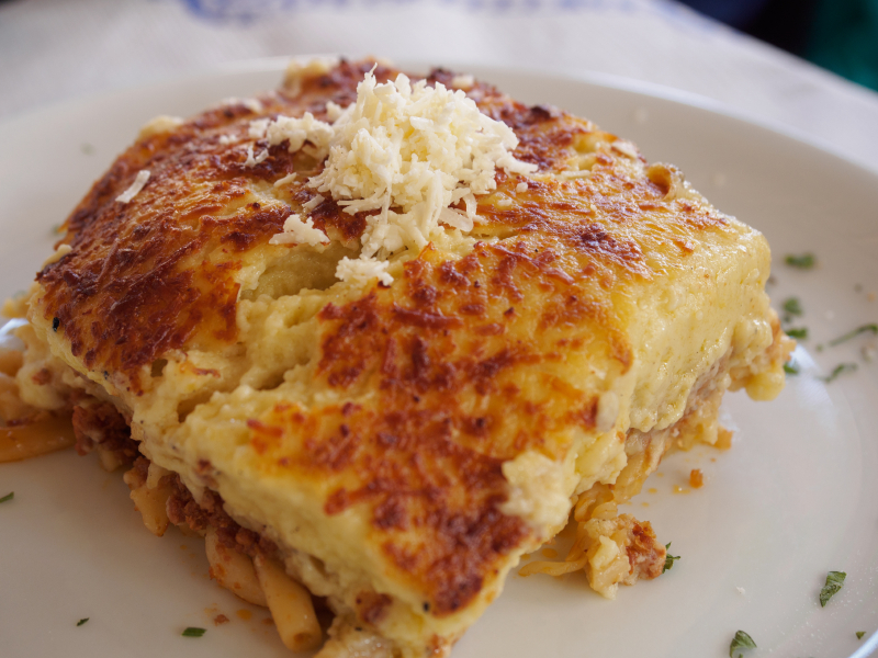 Greek Pastitsio served in a white dish
