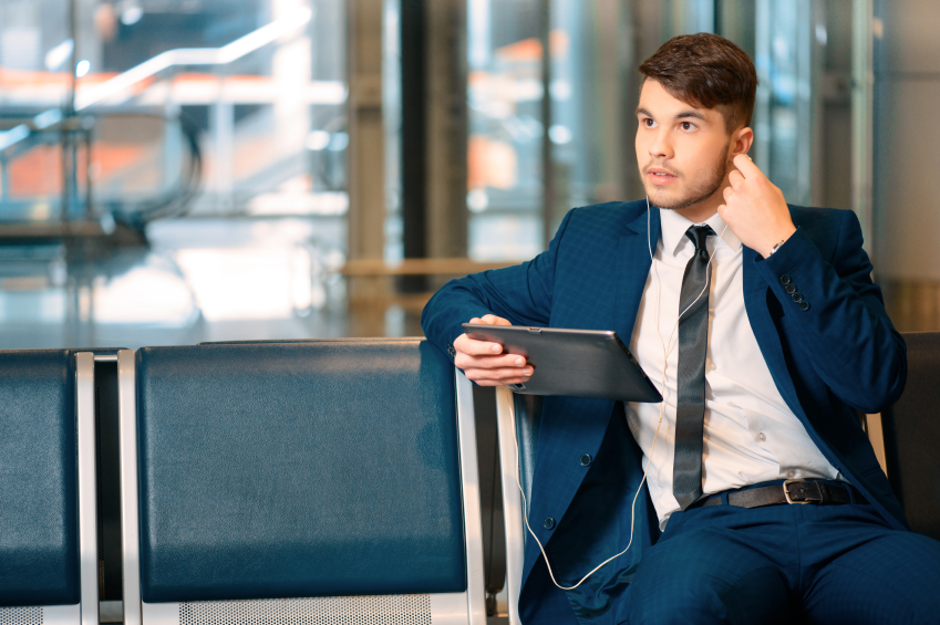 businessman listening to music with earphones
