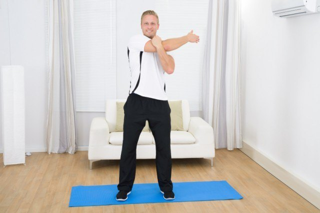 Man stretching before working out