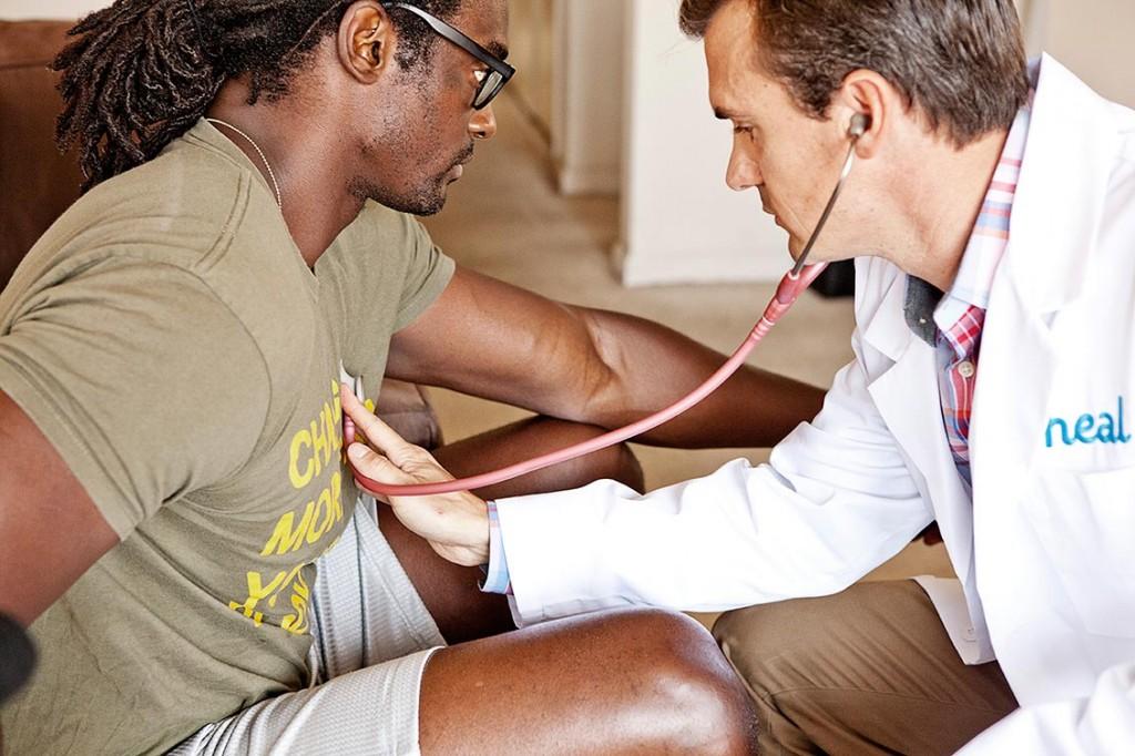A nurse checks a patient's heartbeat