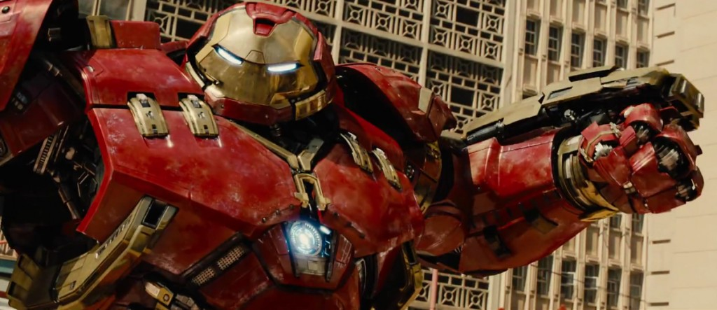 A person in Hulkbuster armor holds up their weaponized arms in Avengers: Age of Ultron