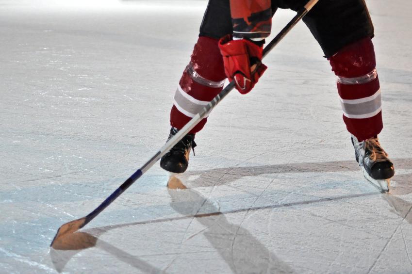 ice hockey player holding a stick