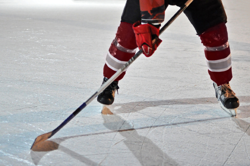 ice hockey player holding a stick
