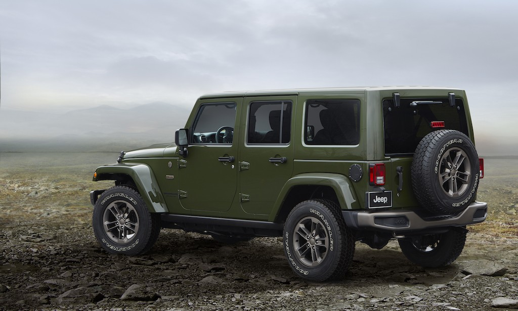 View of green 2016 Jeep Wrangler on mountaintop
