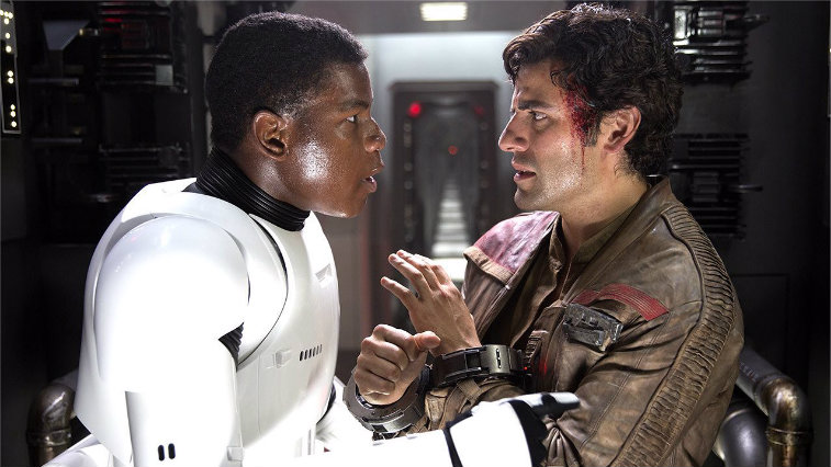 Finn and Poe having an intense conversation in a closed corridor, while Poe is in cuffs