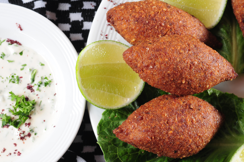 dish of Kibbeh with sauce